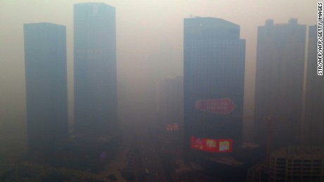 A residential block covered in smog in Shenyang, China's Liaoning province,  November 8, 2015.