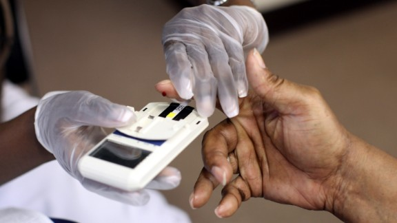 NEWARK, NJ - AUGUST 13:  A mans finger is pricked to test his cholesterol at the City of Newark's free homeless health fair at the Department of Child and Family Well-Being on August 13, 2009 in Newark, New Jersey.  The Department of Child and Family Well-Being in partnership with other health organizations gave free medical examinations to the homeless including screening for high blood pressure, cancer, and diabetes.  (Photo by Rick Gershon/Getty Images)