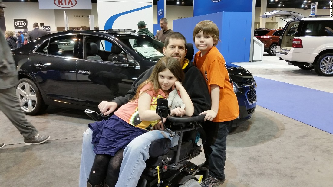 "Masters, 40, poses in February 2015 with daughter Sabrina, 7, and son Radley, 9.  ""I'm lucky,"" he says. ""Even though I'm wheelchair-bound and my arms don't work and my legs are almost to the point where they don't work, relative to ALS, I'm in great shape. For me, It's been very slow, more of a creepy crawly thing. I'm very thankful."""