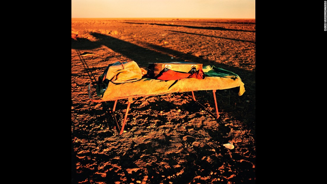 "A camp bed and a stockman's belongings in Rockhampton Downs, Northern Territory, are lit up in golden sunlight. ""It is often blistering hot, terribly dusty and distances are huge. On the other hand, sleeping in a swag with the star packed sky of the southern hemisphere above you makes up for all of that,"" Ludwigson said."