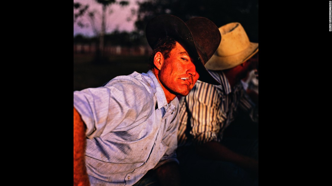 "Men relax after a rodeo at Mataranka Bushman's Carnival in the Northern Territory. ""My pictures are praised to show the real life of Australian cattlemen which I am very proud of,"" Ludwigson said."