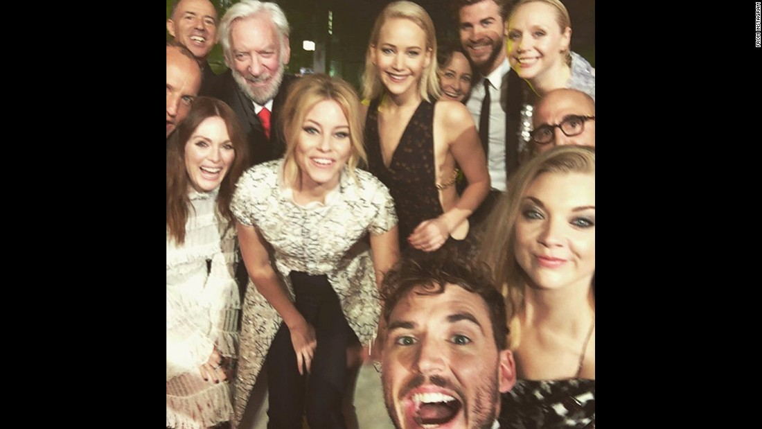 "Members of the ""Hunger Games"" cast take a photo together at the London premiere of ""Mockingjay: Part 2"" on Thursday, November 5. ""This isn't goodbye, it's a see you soon,"" actor Sam Claflin, bottom, <a href=""https://www.instagram.com/p/9tysWApumj/"" target=""_blank"">said on Instagram.</a>"