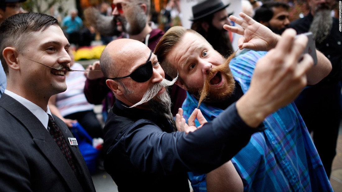 Mustachioed men take a photo together in New York on Friday, November 6. The city was hosting the National Beard and Moustache Championships.