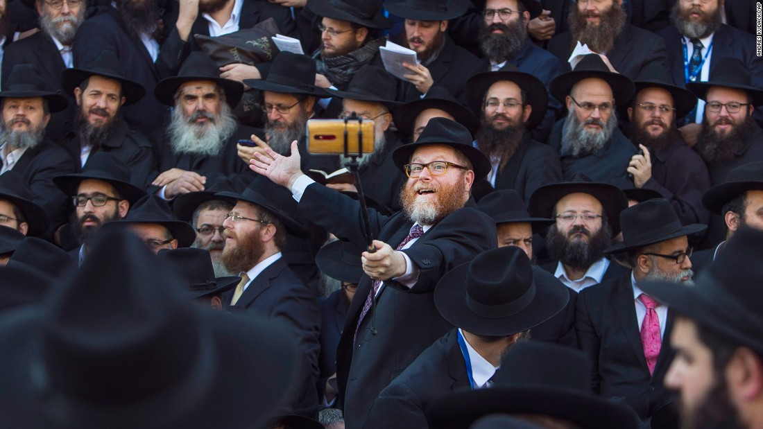 A rabbi uses a selfie stick near the Chabad-Lubavitch headquarters in New York on Sunday, November 8. Thousands of Orthodox rabbis were in town for an international conference.