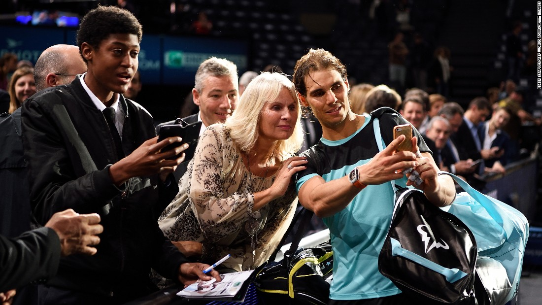 Tennis star Rafael Nadal takes a selfie with a fan at the Paris Masters on Thursday, November 5.