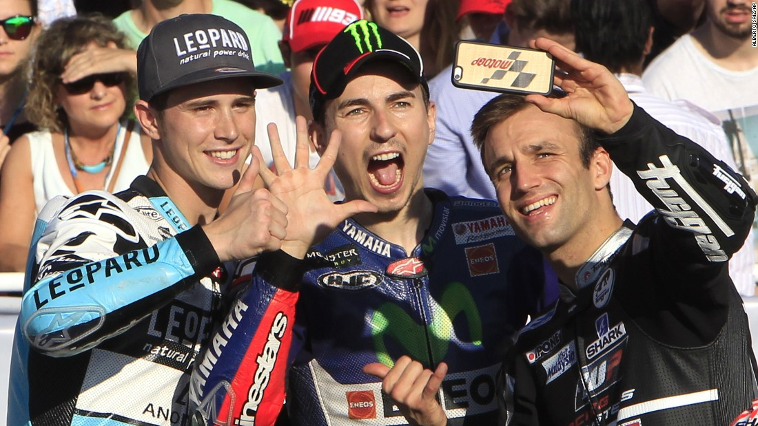 This year's motorcycle racing champions take a selfie together Sunday, November 8, at the end of the Valencia Grand Prix in Cheste, Spain. From right to left are Moto2 champion Johann Zarco, MotoGP champion Jorge Lorenzo and Moto3 champion Danny Kent. MotoGP is the highest of the three levels.
