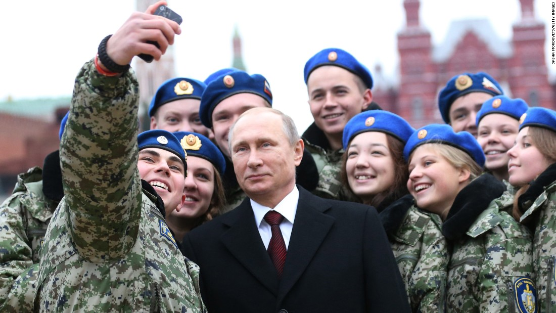 Russian President Vladimir Putin poses with cadets in Moscow's Red Square on Wednesday, November 4. It was National Unity Day in Russia.