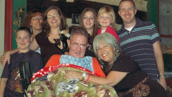 Carlo Russo is surrounded by his children and grandchildren.
