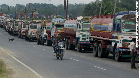 Indian trucks line up near the India-Nepal border at Panitanki on November 3, 2015.