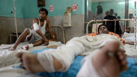 Nepalese activists receive medical treatment at a hospital near the Nepal-India border on November 4, 2015.