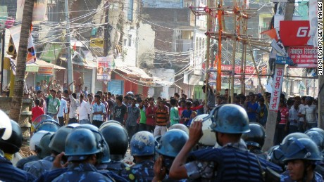 Nepalese police face off with protesters during clashes near the Nepal-India border at Birgunj, some 90 km south of Kathmandu, on November 2, 2015.