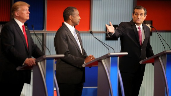 Republican presidential candidate Donald Trump (L) and Ben Carson (C) looks on as U.S. Sen. Ted Cruz (R-TX) speaks during the Republican Presidential Debate sponsored by Fox Business and the Wall Street Journal at the Milwaukee Theatre on November 10, 2015 in Milwaukee, Wisconsin.