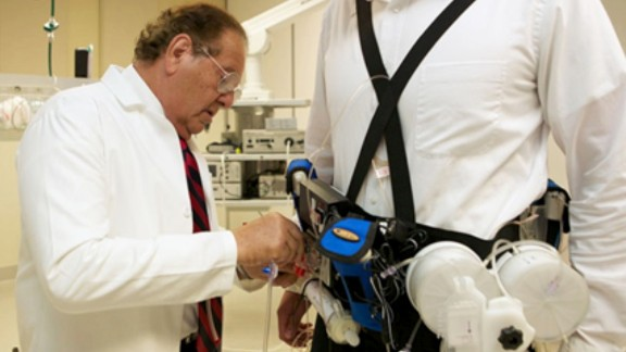 "Victor Gura fits a ""wearable artificial kidney,"" which filters a patient"