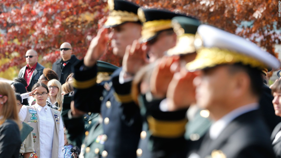 A Girl Scout salutes with U.S. and South Korean troops during a Veterans Day ceremony in Seoul, South Korea.