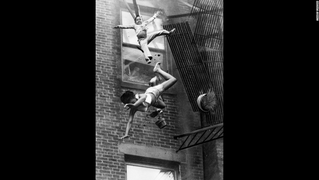 Boston Herald American staff photographer Stanley Forman captured this image of 19-year-old Diana Bryant and her niece falling after a balcony collapsed during a Boston apartment fire on July 22, 1975. Bryant died from the fall and her niece, who landed on her, survived. The photo won the Pulitzer Prize in News in 1976. To capture the image, Forman took a position on the bed of a fire truck and used two Nikons. One was equipped with a 35mm lens. The second included a motor drive and a 135mm lens. He first made a wide angle shot of firefighters trying to rescue Bryant and her niece on the balcony. He then switched to the 135mm anticipating a successful rescue. But the balcony collapsed. Through his Nikon viewfinder and 135mm lens, Forman watched them plunge five stories to the ground as the camera's motor spun. The film was Kodak Tri-X black and white. Exposure is unknown.