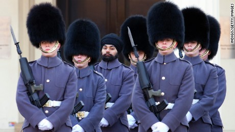 Jatenderpal Singh Bhullar is the first Sikh in the UK's Scots Guard to wear a turban on duty.
