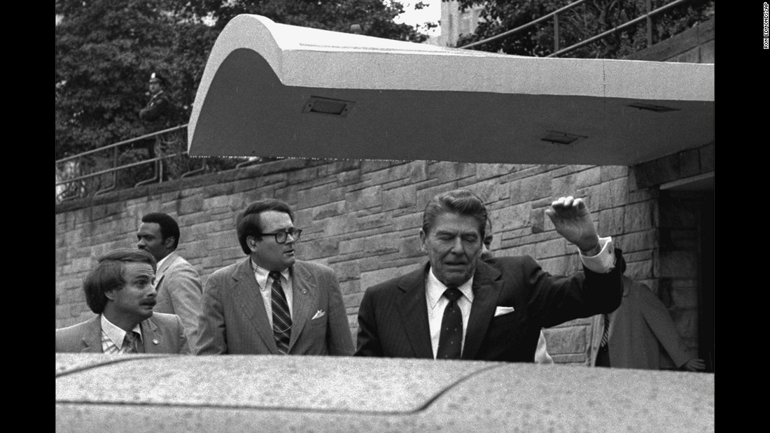 U.S. President Ronald Reagan winces and raises his left arm after being shot in his upper left side outside the Washington Hilton on March 30, 1981. John Hinckley Jr. shot Reagan after waiting for him to exit the hotel. Typically, an AP photographer accompanies the President when he leaves the White House and it was Ron Edmonds' turn that day to cover Reagan's speech at the hotel. At the time of the shooting, Edmonds stood on the opposite side of the presidential limousine from Reagan. Holding a motorized Nikon with a 35-50mm lens, Edmonds touched the camera's button, sending film spinning through the camera at five frames a second. The frames showed the entire sequence of events. As Reagan and the limo sped off to a hospital, Edmonds switched to a Nikon with an 85mm lens and photographed Hinckley's other victims lying on the sidewalk. The camera used Kodak Tri-x film. Its shutter speed and aperture are unknown. Edmonds' images of the failed assassination won the Pulitzer Prize in 1982.