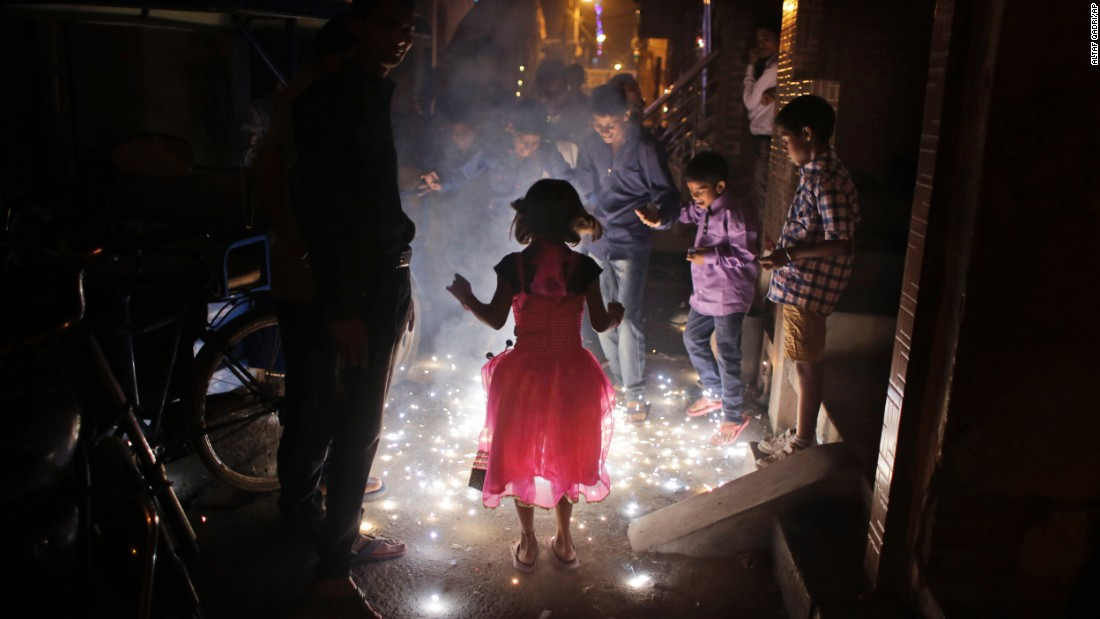 Children play with firecrackers during festivities in New Delhi on November 11.