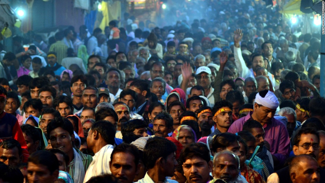 Devotees gather outside of a temple to take part in a religious procession in Chitrakoot, India, on November 11.
