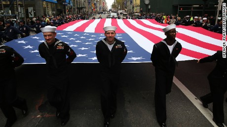 Members of the US Navy march with the American flag in  the Veterans Day Parade in New York last year.