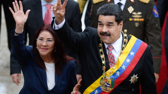Venezuelan President Nicolas Maduro (R) and his wife Cilia Flores (L) wave upon their arrival at the National Assembly for a session commemorating Independence Day in Caracas on July 5, 2015. AFP PHOTO/FEDERICO PARRA        (Photo credit should read FEDERICO PARRA/AFP/Getty Images)