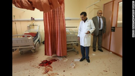 A Palestinian doctor looks at blood on the floor at al-Ahli hospital in Hebron after a man was shot dead during a raid by Israeli undercover agents on Thursday.