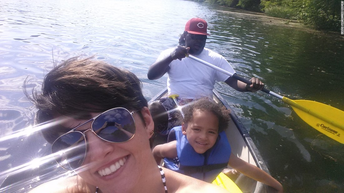 Karen Garsee and her family canoeing on Lady Bird Lake in Austin, Texas.