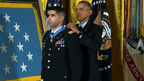 Army Capt. Florent A. Groberg receives the Medal of Honor from President Barack Obama during a White House ceremony on November 12 for his actions in Afghanistan. Groberg was born in France, lived in Spain and later moved with his family to the United States, where he became a naturalized U.S. citizen in 2001. Groberg saved lives when he tackled a suicide bomber in August 2012.