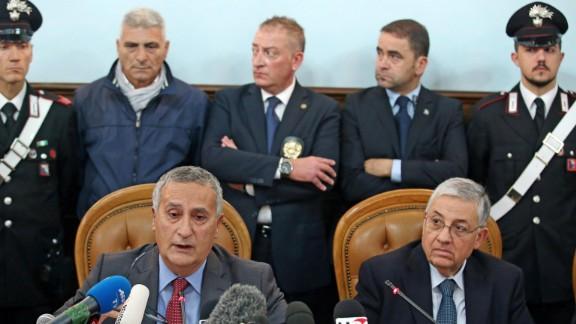 Italian anti-Mafia prosecutor Franco Roberti, left, and Rome public prosecutor Giuseppe Pignatone announce the arrests Thursday.