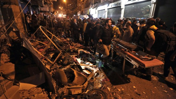 Emergency personnel and civilians gather at the site of a twin suicide bombing in Beirut, Lebanon, on Thursday, November 12. The bombings killed at least 43 people and wounded more than 200 more. ISIS appeared to claim responsibility in a statement posted on social media.