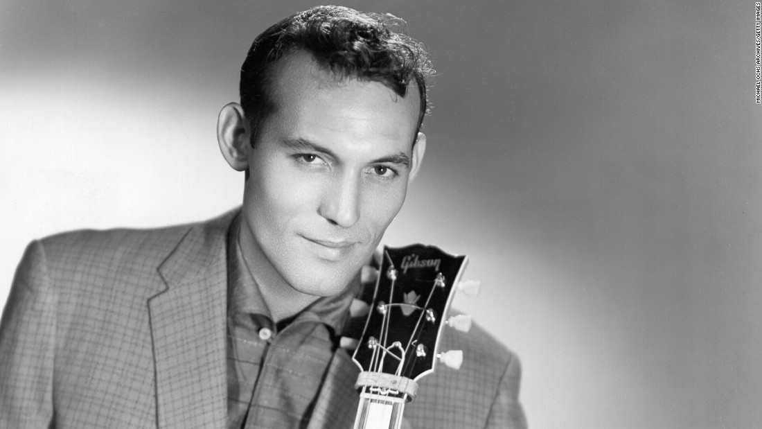 "Another Phillips discovery, Carl Perkins, wrote and recorded the song ""Blue Suede Shoes."" When the song was released in early 1956, it topped the country, R&B and pop charts -- the first song with such crossover success, indicating that ""rock 'n' roll"" had broad appeal. Perkins stayed with Sun until 1958."