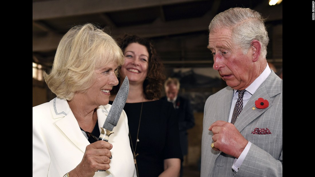 Britain's Prince Charles jokes with his wife Camilla, Duchess of Cornwall, during a visit to Seppeltsfield Winery in the Barossa Valley, Australia, on Tuesday, November 10. The royal couple are on a six-day tour of Australia.