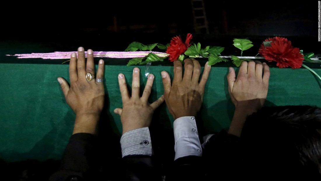 "Men carry one of the coffins for the seven people <a href=""http://www.cnn.com/2015/11/11/asia/afghanistan-unrest/"" target=""_blank"">who were killed</a> by unknown militants during a protest procession in Kabul, Afghanistan, on Tuesday, November 10.<br />"