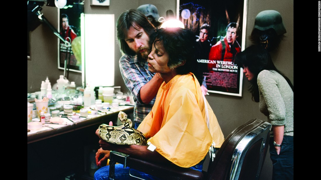 """Baker didn't have much time for others on the film. The dancers weren't cast immediately, so Baker kept their zombie makeup fairly simple. """"We'd only have three days from meeting the dancers to finishing their faces,"""" he said. But Jackson was well cared-for. In this photo, Jackson holds Muscles, his pet boa constrictor."""