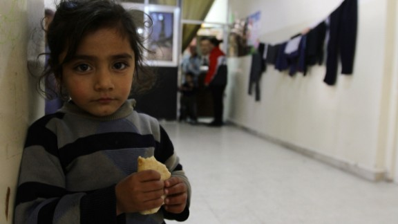 A Syrian refugee is seen at the Taqi Al-Din school in the Dumar neighbourhood of Damascus where many families are taking shelter on February 26, 2013. The Syrian conflict has already claimed more than 70,000 lives in the two years since President Bashar al-Assad