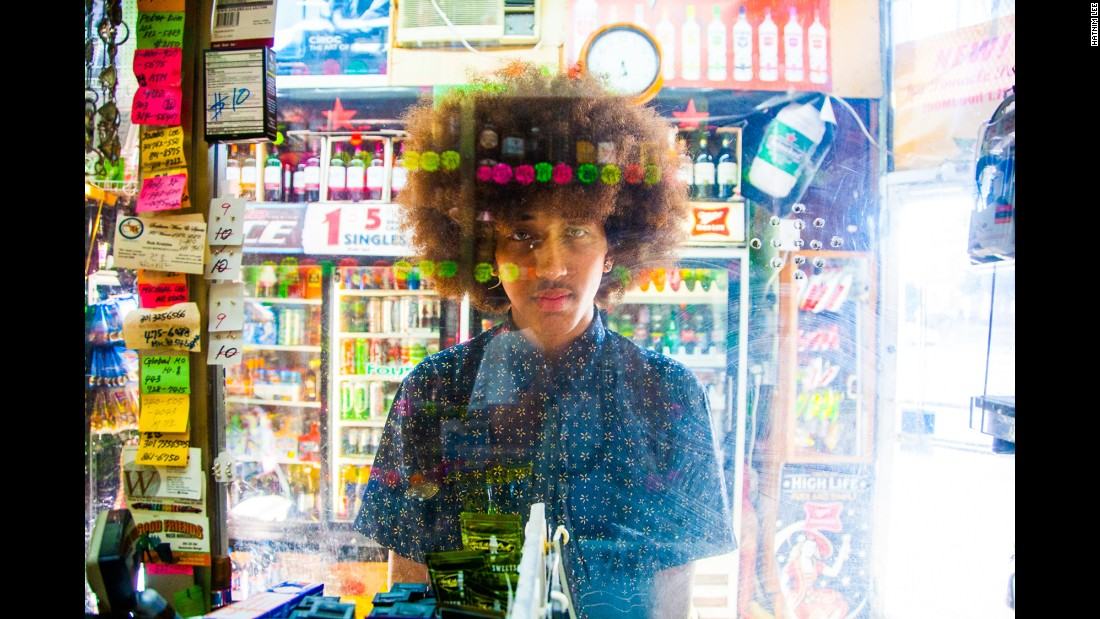 "For 15 years, Hatnim Lee has been photographing customers at her parents' liquor store in Washington. She calls her portrait series ""Plexiglass."""