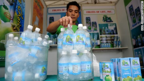 This photo taken on August 30, 2012 shows a vendor displaying coconut water products during the 26th National Coconut Week Celebration at the Philippine Coconut Authority building in Manila. After centuries of replenishing Filipinos, the mineral-rich liquid of coconut water has become a must-have health drink thanks to aggressive marketing by a beverage industry looking to offset soda sales that have lost their fizz.