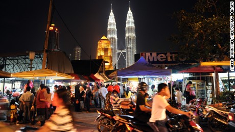 A view of Malaysia's landmark Patronas Twin Towers shortly before lights are switched off for Earth Hour in Kuala Lumpur on March 27, 2010.