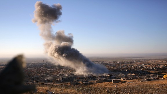 Smoke rises over the northern Iraqi town of Sinjar on November 12. Kurdish Iraqi fighters, backed by a U.S.-led air campaign, retook the strategic town, which ISIS militants overran last year. ISIS wants to create an Islamic state across Sunni areas of Iraq and Syria.