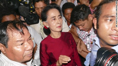 In this Nov. 8, 2015 file photo, Myanmar opposition leader Aung San Suu Kyi leaves after casting her ballot at a polling station in Yangon.