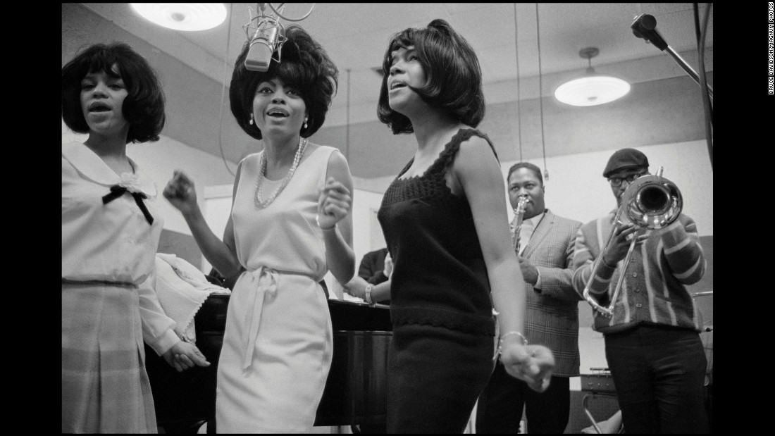 "The group began as a trio consisting of Diana Ross, Florence Ballard and Mary Wilson. The three met while living in a housing project in Detroit, and they rose to fame with Motown Records in the 1960s. ""I photographed them as a group. Diana wasn't famous-famous at that point,"" Davidson said. ""They seemed to be very mellow."""