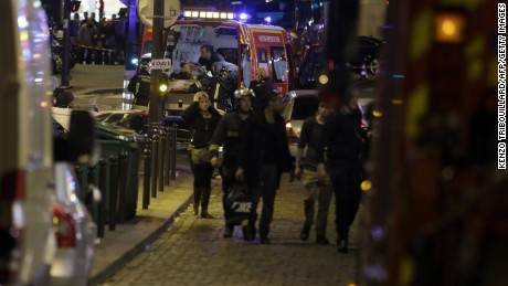 Security moves people along Rue Bichat following a string of attacks in the French capital Paris on November 13, 2015. At least 18 people were killed as multiple shootings and explosions hit Paris Friday, police said. Police also said there was an ongoing hostage crisis in the Bataclan a concert hall in the French capital. AFP PHOTO / KENZO TRIBOUILLARDKENZO TRIBOUILLARD/AFP/Getty Images