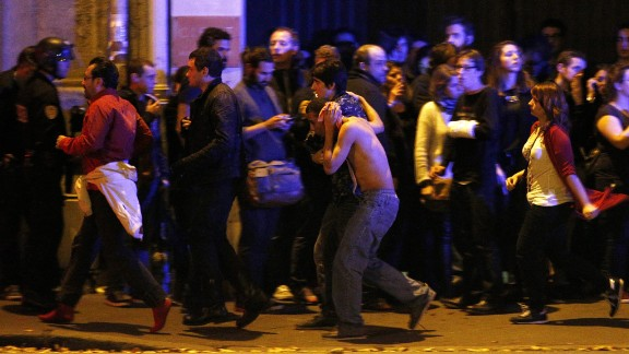 Wounded people are evacuated outside the scene of a hostage situation at the Bataclan theater in Paris on November 13.