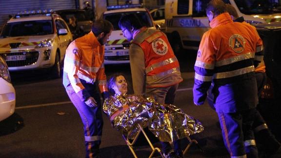 Medics evacuate an injured woman on Boulevard des Filles du Calvaire near the Bataclan early on November 14.