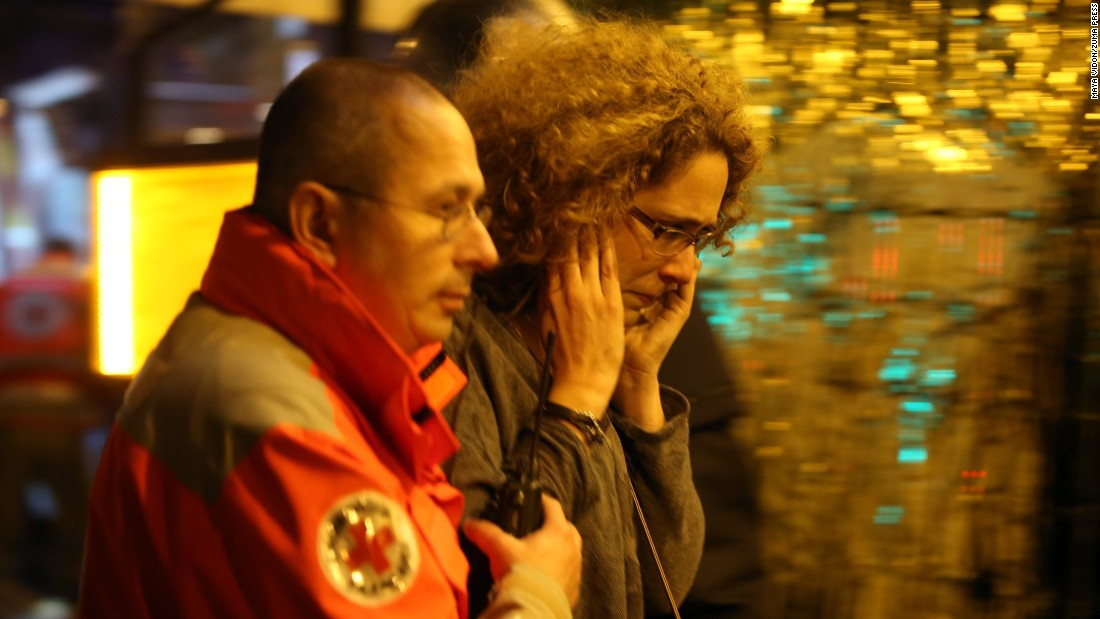 Victims of the shooting at the Bataclan concert venue in central Paris are evacuated to receive medical treatment on November 14.