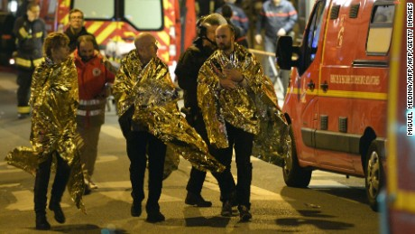 People are being evacuated on rue Oberkampf near the Bataclan concert hall in central Paris, early on November 14, 2015. At least 120 people were killed in a series of terror attacks in Paris on November 13 according to a provisional total, a source close to the investigation said. AFP PHOTO / MIGUEL MEDINAMIGUEL MEDINA/AFP/Getty Images
