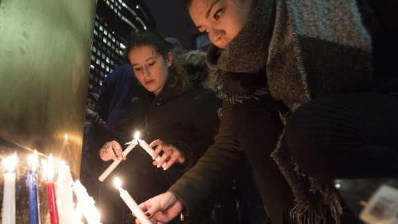 "People light candles at a vigil outside the French consulate in Montreal, Friday, Nov. 13, 2015. Canadian Prime Minister Justin Trudeau offered ""all of Canada"