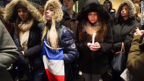 "People attend a vigil outside the French consulate in Montreal, Friday, November 13. Canadian Prime Minister Justin Trudeau offered ""all of Canada's support"" to France on Friday night in the wake of ""deeply worrying"" terrorist attacks in Paris that killed at least 120 people."