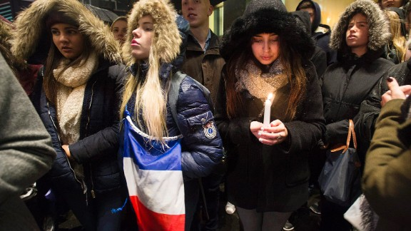 "People attend a vigil outside the French Consulate in Montreal. Prime Minister Justin Trudeau offered ""all of Canada"
