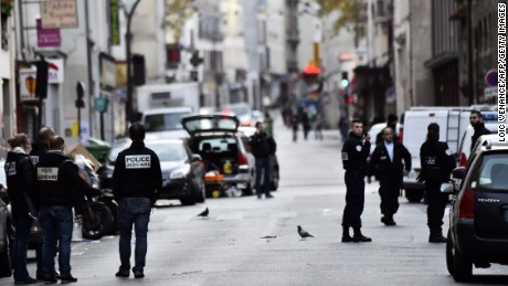 Police are seen near the Cafe La Belle Equipe at the Rue de Charonne in Paris on November 14, 2015, following a series of coordinated attacks in and around Paris late Friday which left more than 120 people dead.  AFP PHOTO / LOIC VENANCE        (Photo credit should read LOIC VENANCE/AFP/Getty Images)